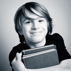 schoolboy portrait with books