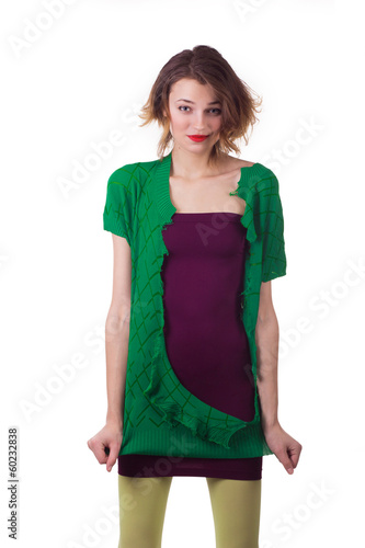 woman tearing her green blouse