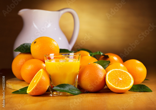 glass of orange juice with fresh fruits