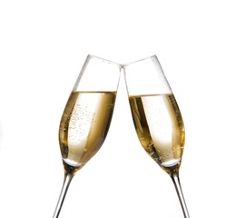 champagne flutes with golden bubbles make cheers on white