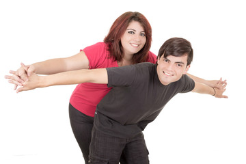 Happy alternative couple with arms open flying