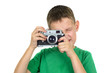 Boy taking photos by vintage camera