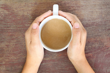 Coffee cup in woman hand