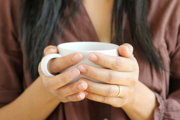 coffee cup in woman hand.