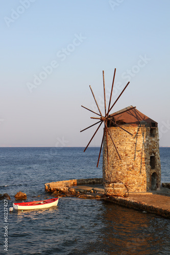 Old Greek Windmill and Wooden Boat