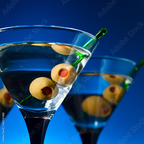 glasses with martini and green olives