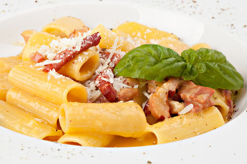 Italian pasta plate with prosciutto and parmesan cheese