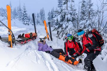 Ski patrol team rescue woman broken leg