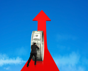 businessman pushing money circle on growing red arrow with sky