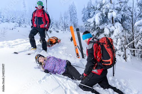 Rescue ski patrol help injured woman skier - 60238417