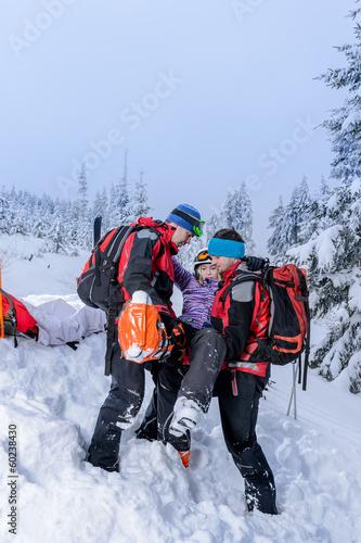 Ski patrol carry injured woman skier stretcher - 60238430