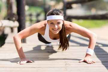 healthy woman doing pushups