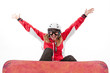 Female snowboarder jumping, isolated on white background
