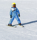 Girl on skis in soft snow