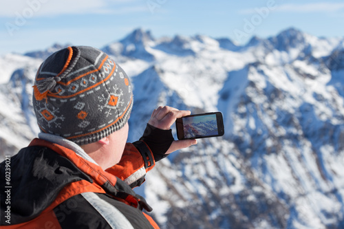 man photographed in smartphone.