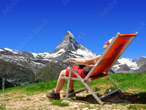 Girl in the Swiss Alps.On the background Mount Matterhorn.