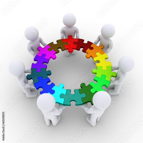 People holding puzzle pieces connected in a circle