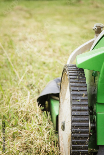 Closeup of lawnmower in the garden ready to cut