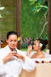 Indonesian women having wellness bath drinking tea