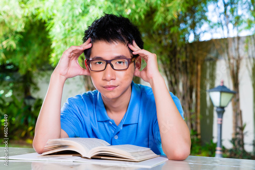 Young Chinese Boy with homework for school