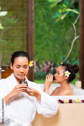 Indonesian women having wellness bath drinking tea