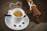 cup of coffee with heart of steam, cinnamon sticks and anise