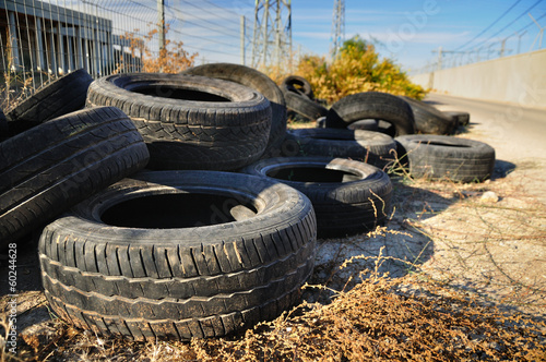 Pile of used tires in industrial zone .