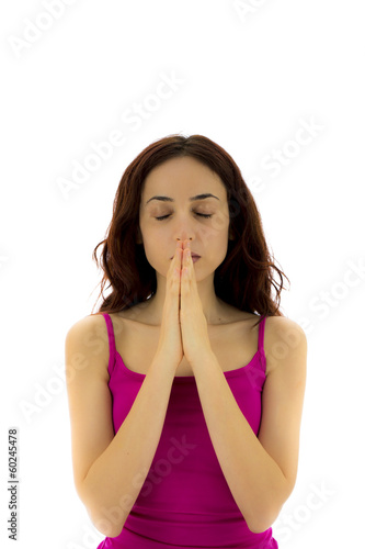 Woman doing Namaste pose in yoga