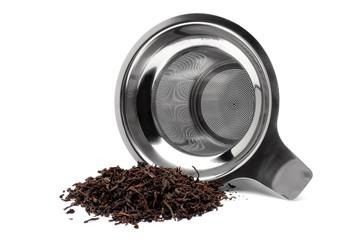 Tea strainer with a handful of tea
