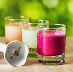Vegetable smoothie on wooden table on the rural background
