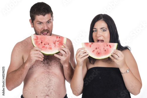Deaf man and woman eating water melon