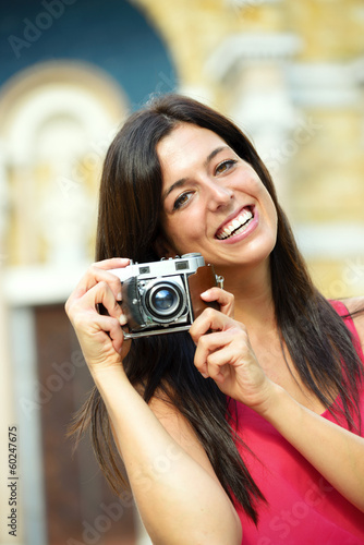 Woman with camera taking photo