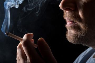 Portrait man smoking cigarette