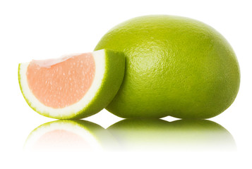 green grapefruit and slices on white background