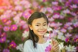 Little asian girl in a garden
