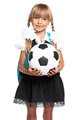 Little schoolgirl with soccer ball