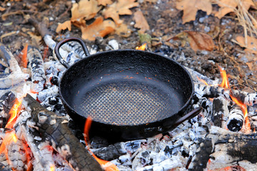 frying pan on embers