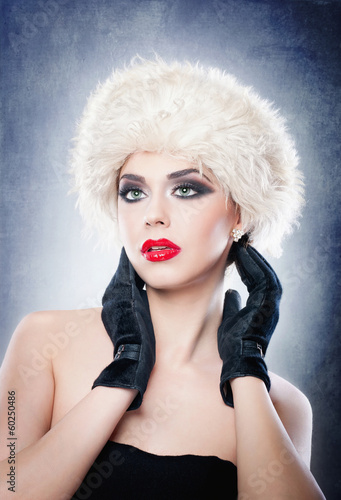 Attractive young Caucasian adult with black gloves isolated
