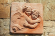 decorative  tile with hugging two angels hanging  on  wall
