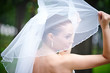 Happy bride keeps veil