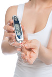 Diabetes patient woman measuring glucose level blood test