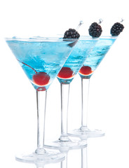 blue martini cocktails row composition with alcohol