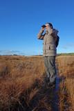 woman with binoculars birdwatching poster