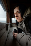 birdwatching, a woman with binoculars poster