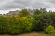 Carcassonne old fortified city behind woods with stormy sky