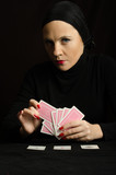 Woman in black with playing cards