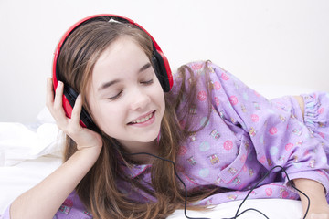 Teen girl listening music in the room