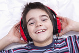 preteen boy listening music in the room
