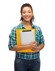 smiling black student with folders and tablet pc