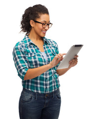 smiling black student in eyeglasses with tablet pc
